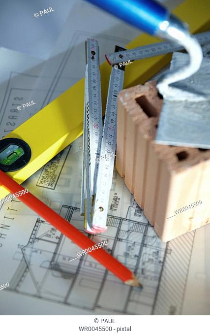 Close-up of blueprint with work tools