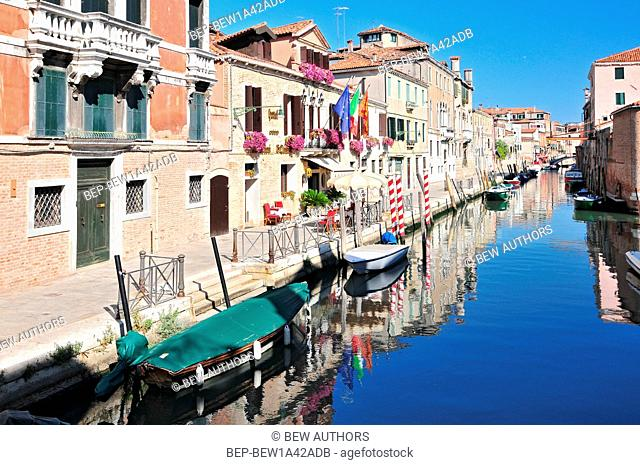 Venice cityscape narrow water canal bridge and traditional buildings. Italy Europe