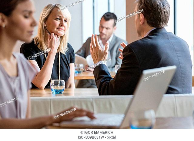 Businessmen and businesswomen working