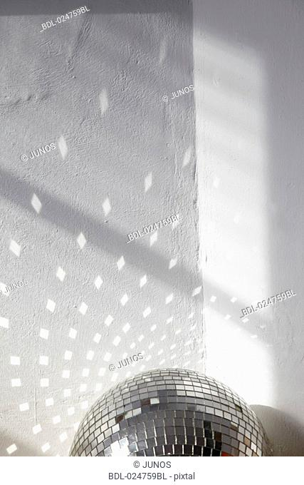 reflections of disco ball on wall