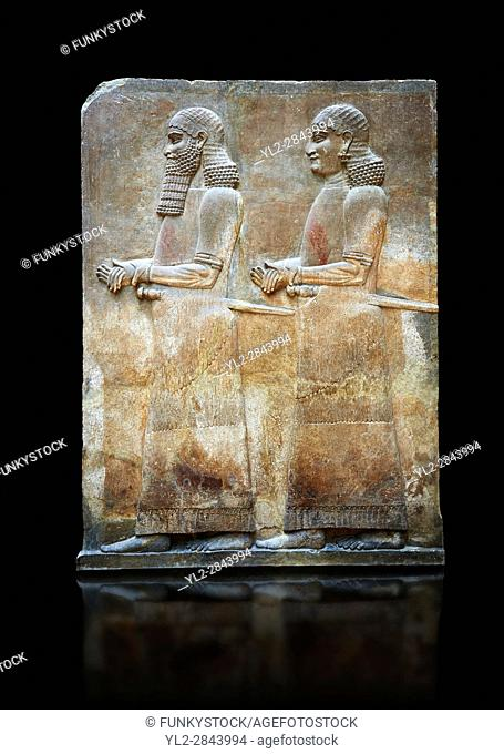 Stone relief sculptured panel of two functionaries. Room 811. Inv AO 19876 from Dur Sharrukin the palace of Assyrian king Sargon II at Khorsabad, 713-706 BC