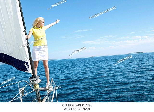 Woman overlooking sea on sailboat, Adriatic Sea