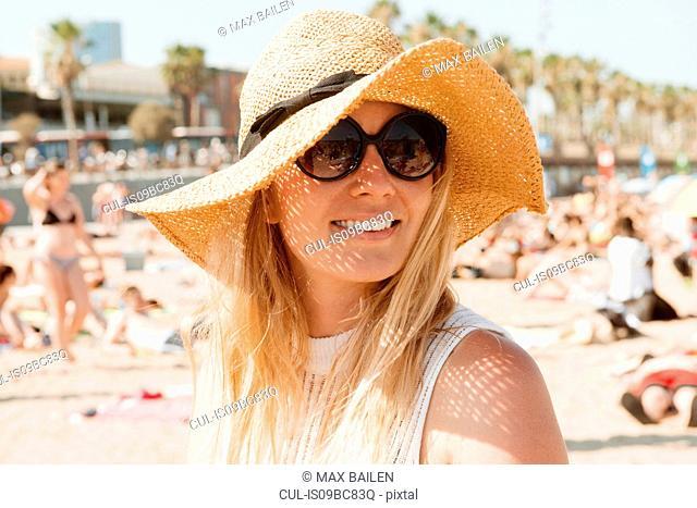 Portrait of woman on beach, Barcelona, Catalonia, Spain