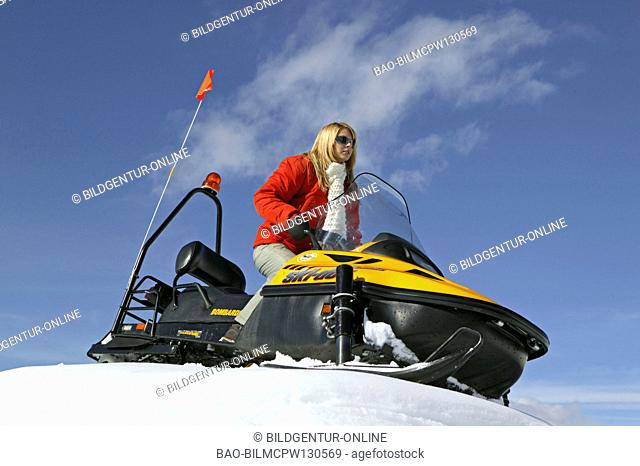 Woman on Ski Scooter Winter Holiday