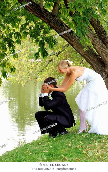 Newlyed couple by lake