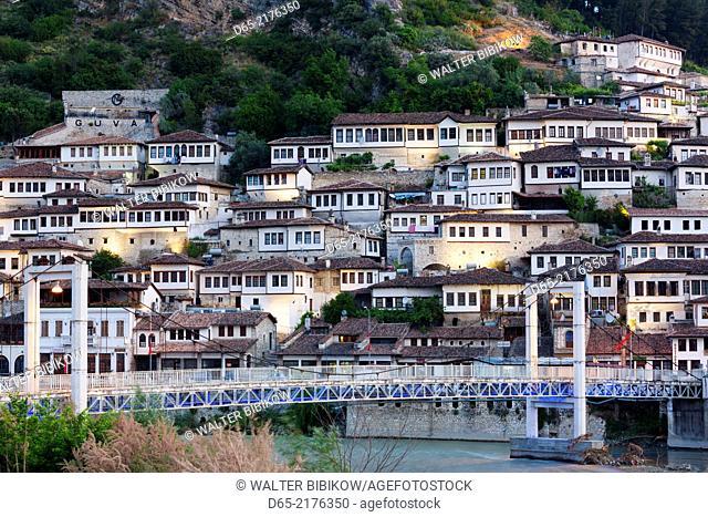Albania, Berat, Osumi River Pedestrian Bridge and Ottoman-era buildings, dawn