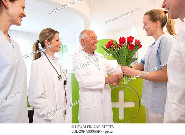 Medical team thanking doctor