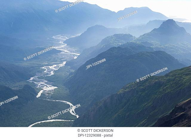 A River Winding Through A Valley In The Kenai Mountains, Kachemak Bay State Park; Alaska, United States Of America