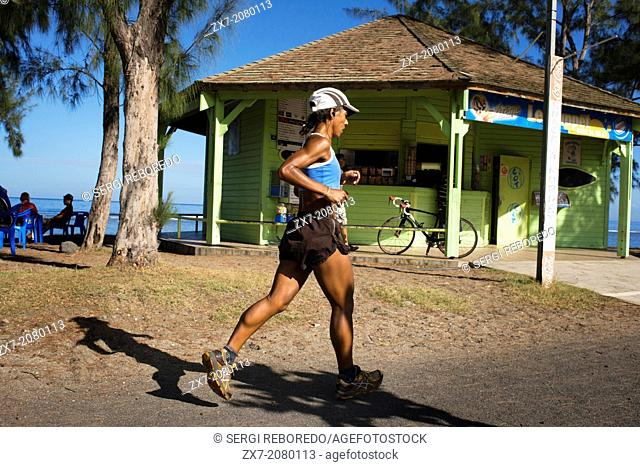 Running on the beach in Saint Leu. Saint-Leu is a municipality in the French overseas department of Reunion. It is located on the west side of the island of...