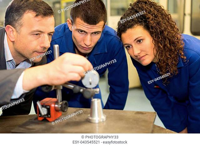 Students watching engineering experiment
