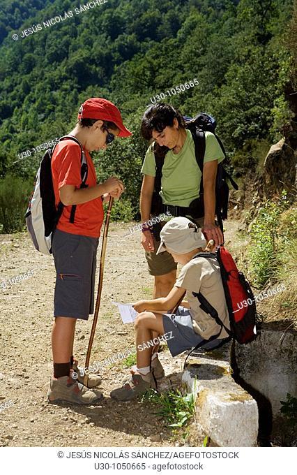 family walking along a route in Liébana valley  Picos De Europa National Park  Cantabria  Spain