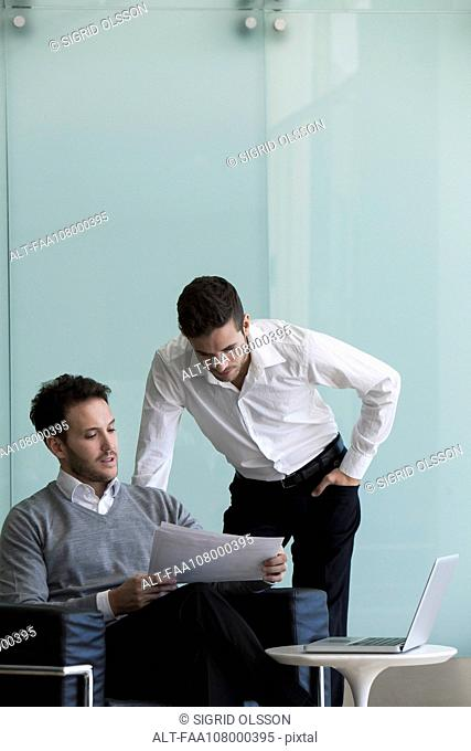 Business colleague reviewing document together