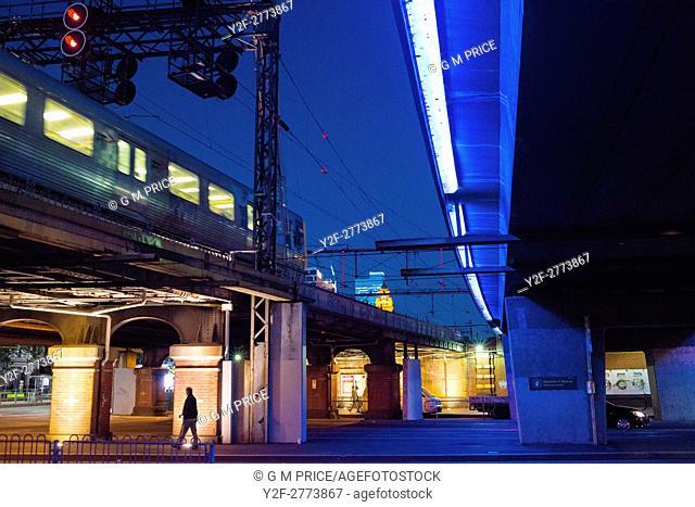 traffic and pedestrians under rail line near Market Street, Melbourne