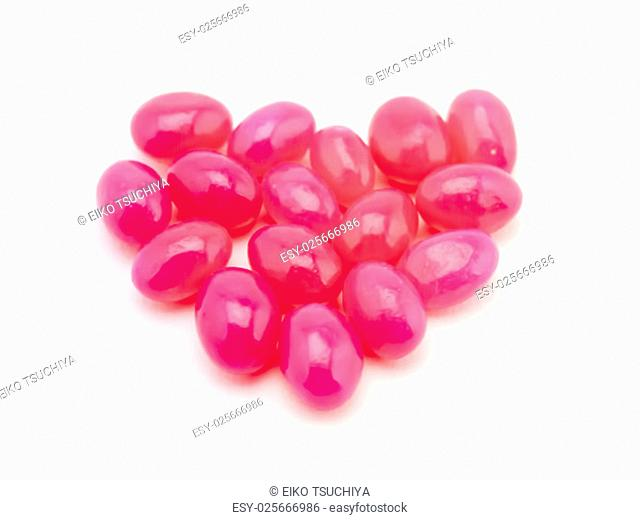 Cute colorful jelly beans on white background