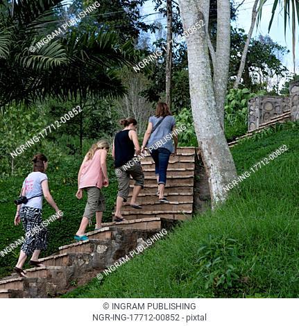 Female tourists moving up on staircase, Finca Santa Isabel, Copan Ruinas, Honduras