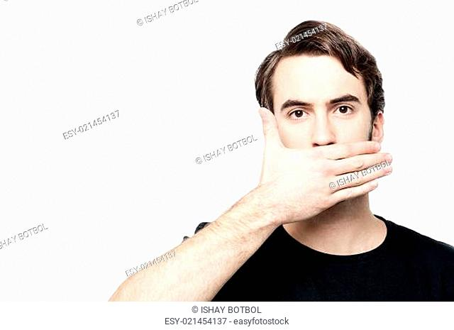 Man cover his mouth, speak no evil concept