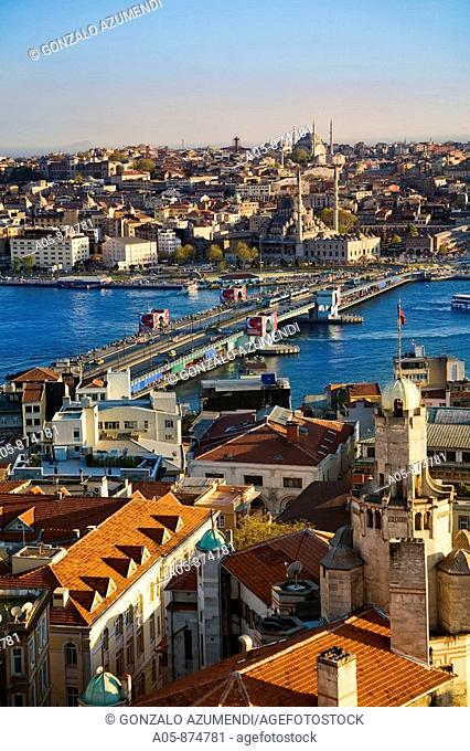 Galata Bridge with Galata district at fore and New Mosque on the opposite side, Istanbul, Turkey