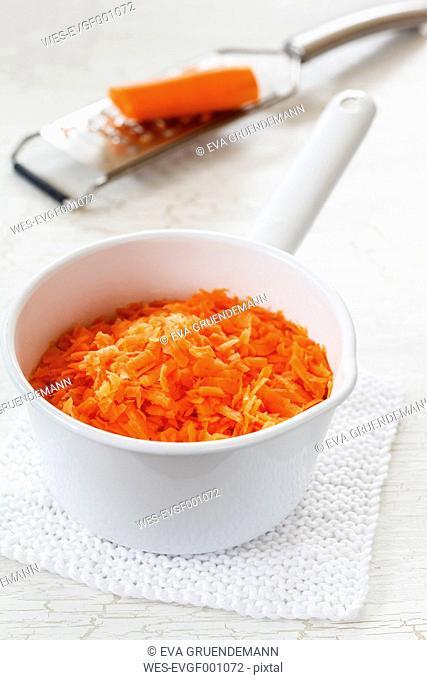 Grated carrots in saucepan