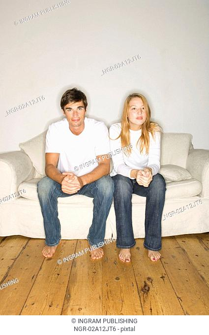 Young couple sitting on a couch