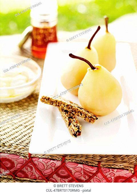 Dish of cooked pears and biscuits