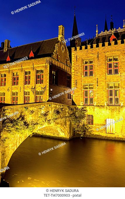 Illuminated townhouses and bridge