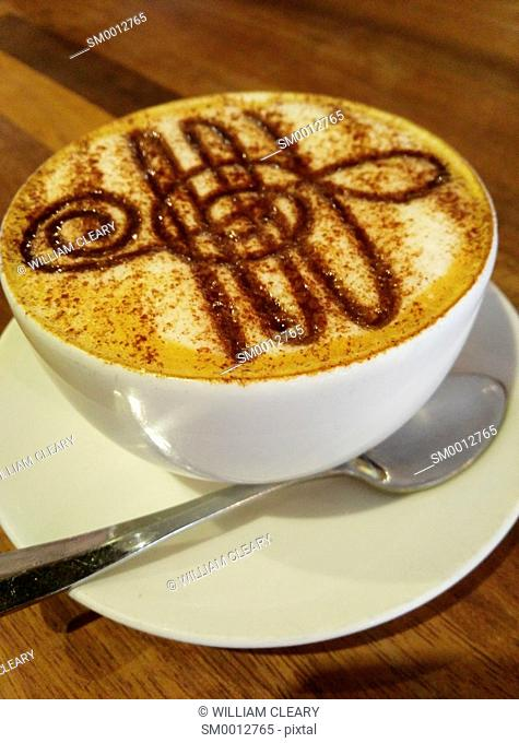 Cappuccino with a Treble Clef formed in the froth with Chocolate