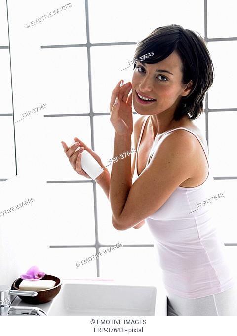 Woman in white underwear in front of mirror