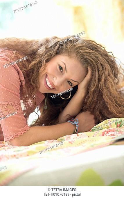 Portrait of woman lying in bed