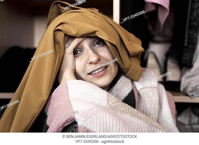 young woman overwhelmed by her garments