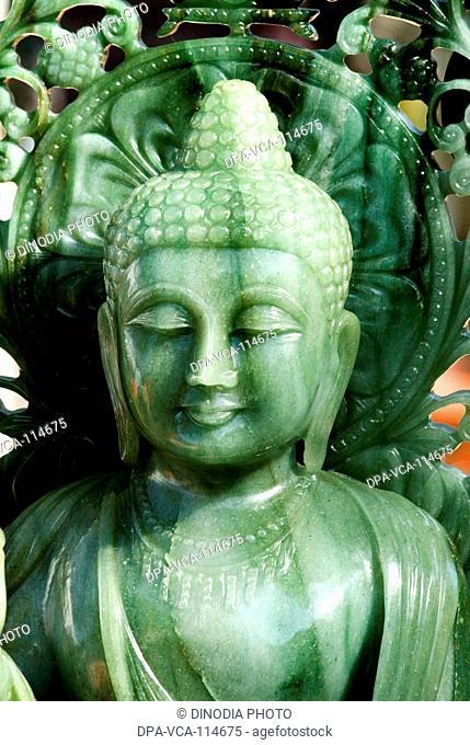 Statue of Gautam Buddha at a shop  ; Bombay Mumbai ; Maharashtra ; India