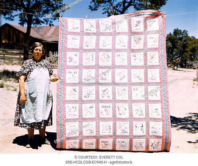 Mrs. Bill Stagg with state quilt that she made, Pie Town, New Mexico. October, 1940. Russel Lee, photographer