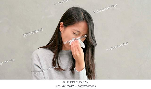 Woman sneezing and cough