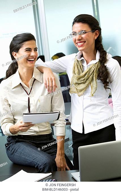 Hispanic businesswomen working together in office