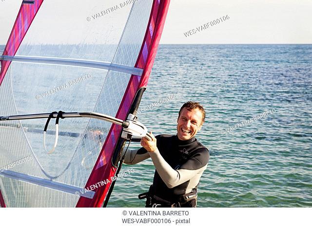 Happy man windsurfing on the sea