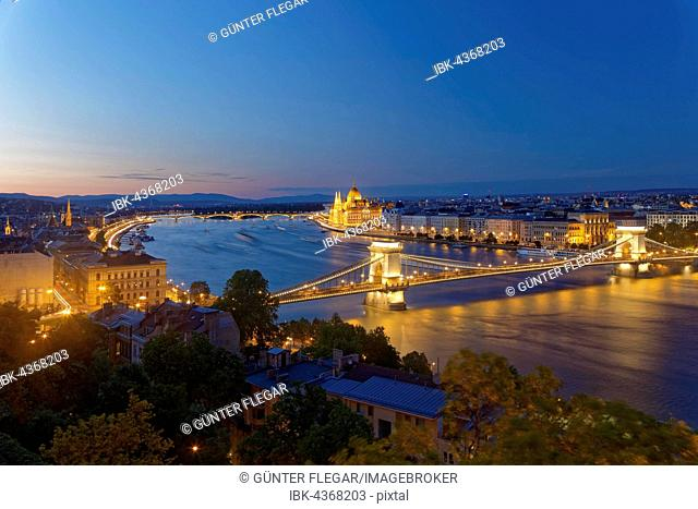 View of Chain Bridge at dusk, Danube and Parliament Building, Pest, Budapest, Hungary