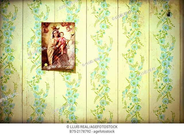 Interior of a house with wall paper and a picture of the Virgen del Carmen. Mahon, Menorca, Balearic Islands, Spain, Europe