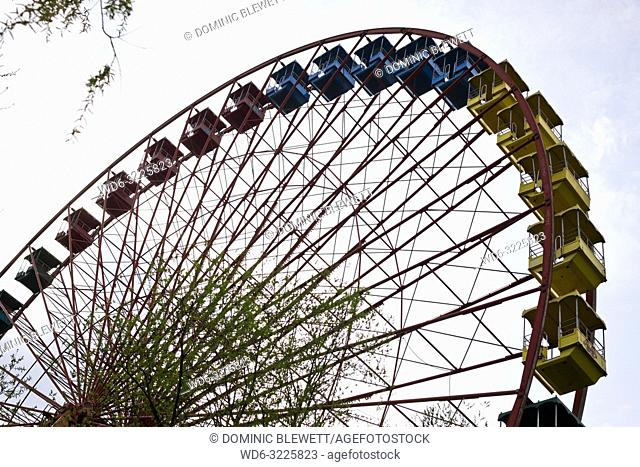 A view of the unused big wheel in the abandoned Spreepark in Berlin, Germany