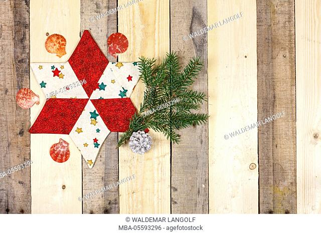 Christmas decoration, star made of fabric, twig, scallop
