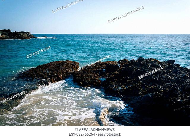 View of rocks in the Pacific Ocean from Table Rock Beach in Laguna Beach, California