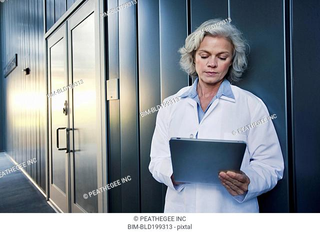 Doctor using digital tablet outdoors