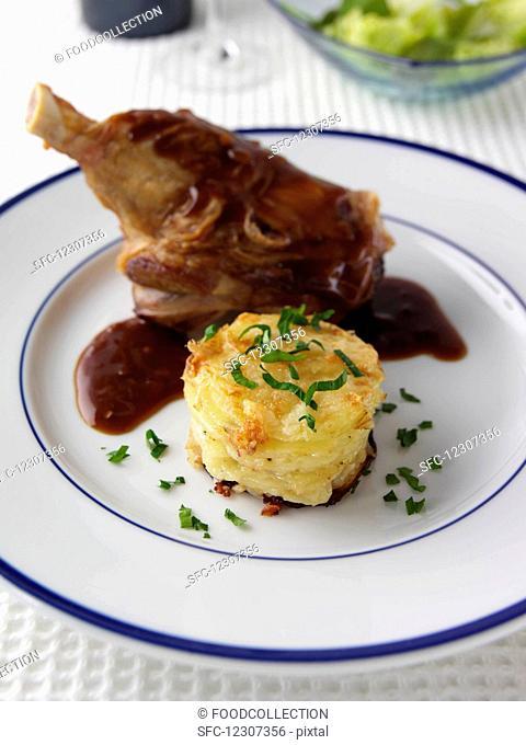 Lamb shank with potato tower editorial food