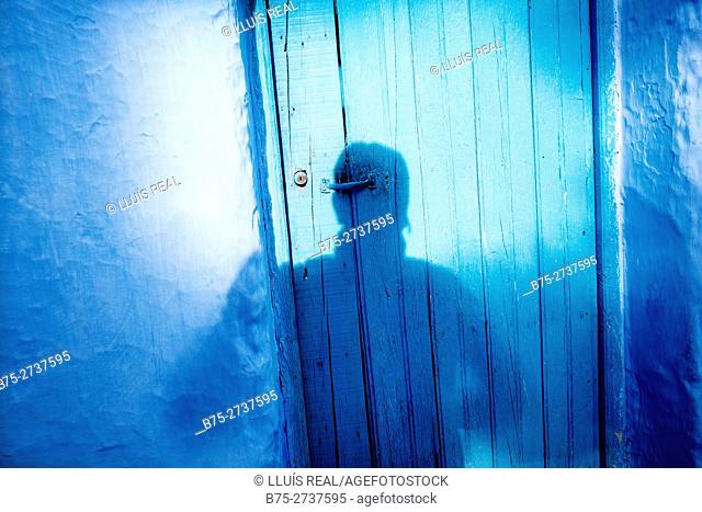 Shadow of the photographer on blue door. Chauen, Morocco