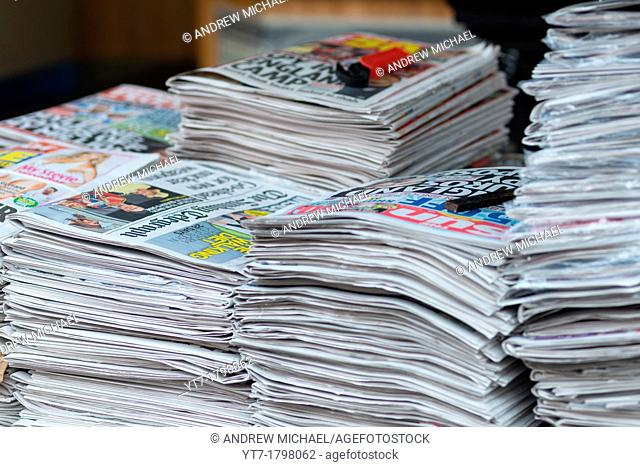 British newspapers on sales at stall in London, England
