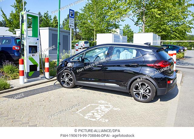 19 June 2019, Hamburg: An Opel Ampera-e is standing at an ultra fast charging column with up to 350 kW charging power during a press appointment