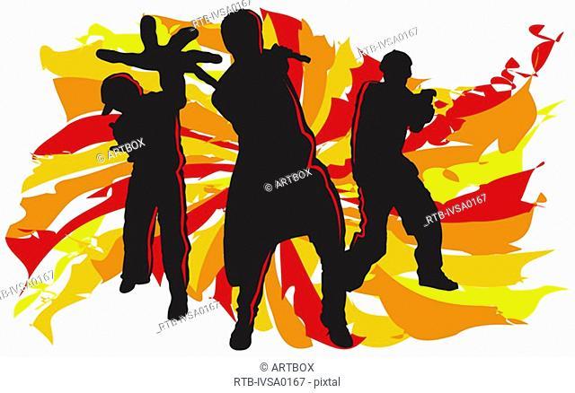 Silhouette of three people breakdancing