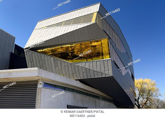 Futuristic architecture of the Perimeter Institute building reflecting the historic Waterloo Central Railway in Spring