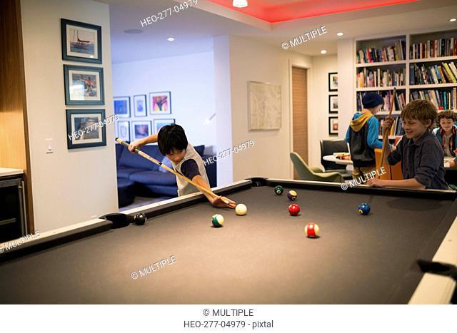 Boys playing pool at pool table