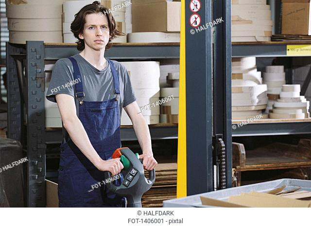 Portrait of young male worker working in warehouse