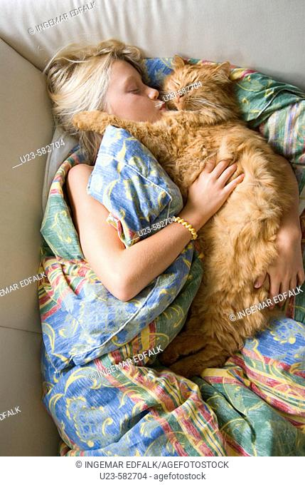 Girl resting with her cat