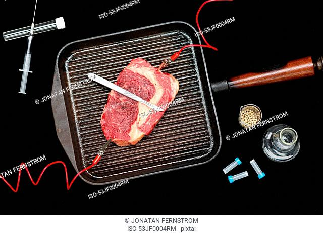 Meat connected to electrodes